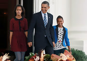 This crimson polka-dotted dress looked sweet and stunning on Malia Obama.