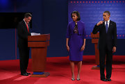 Michelle Obama wore a lovely purple skirt suit with a cropped jacket for the first presidential debate in Denver.