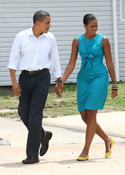 Michelle Obama was in the mood for bright colors, pairing yellow ballet flats with her turquoise dress.