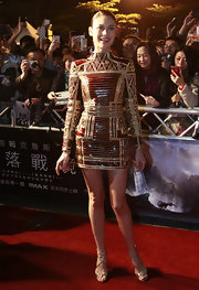 Olga Kurylenko showed her daring fashion side with this micro-mini dress, which features long sleeve, and a high neck.