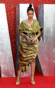 Rihanna sealed off her look with a metallic clutch by Christian Louboutin.