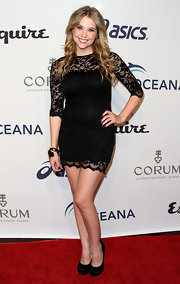 "Ashley Benson posed in black satin platform pumps. The heels perfectly matched the ""Pretty Little Liars"" star's long-sleeved lace mini."