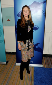 Diane Lane completed her chic ensemble with a pair of black Prada boots.