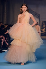 Grace Elizabeth floated down the Off-White catwalk in a nude tulle one-shoulder gown with a voluminous tiered skirt.
