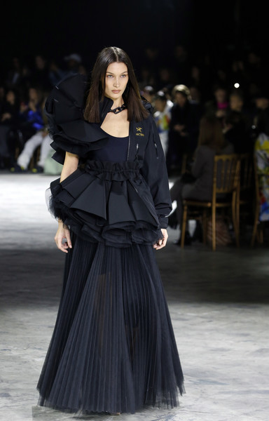 Bella Hadid looked like a work of art in a ruffled navy gown/jacket hybrid while walking the Off-White runway.