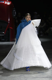 Gigi Hadid walked the Off-White runway rocking a voluminous white one-shoulder gown layered over a blue hoodie.