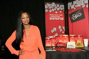 Garcelle Beauvais attended the 2012 Independent Spirit Awards wearing a glossy dark coral nail polish to coordinate with her vibrant orange dress.