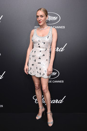 Chloe Sevigny teamed her frock with strappy silver sandals by Aquazzura.