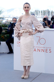 Lily Collins made an alluring choice with this striped, off-one-shoulder blouse by Johanna Ortiz for the Cannes Film Festival photocall for 'Okja.'