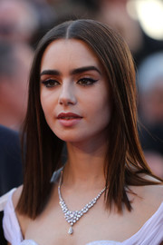Lily Collins showed off a beautiful diamond chandelier necklace by Bulgari at the Cannes Film Festival screening of 'Okja.'