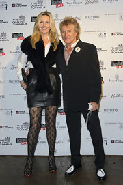 Penny Lancaster wore a pair of hot tights inside  her leather skirt at a fundraising event.