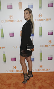 Nina Agdal accessorized with tricolor chain-strap bag by Sandro at the OleHenriksen brand relaunch celebration.