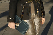 Olga Sorokina opted for an over-sized clutch with a gold owl embellishment to give her daytime look some extra fun!