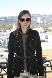 A classic belted tweed jacket gave Olga Sorokina a timeless look while posing for pictures in LA.