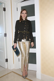 Olga Sorokina dressed up a casual tweed jacket with metallic gold skinny pants and heels while out in LA.