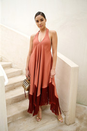 Olivia Culpo looked breezy in a coral halter dress with a contrast fringe hem at the Cult Gaia runway presentation.
