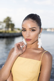 Olivia Culpo accessorized with a pair of statement tassel earrings by Kendra Scott.