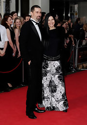 Margherita Ronchi exuded 60s style in her printed black-and-white wide-leg pants.