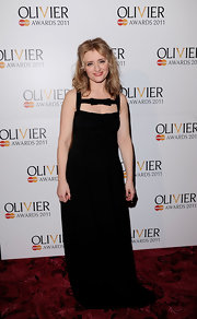 Anne adds a feminine touch to the black evening gown with a bowed neckline design for the Olivier Awards.