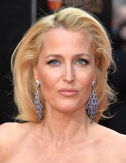 Gillian Anderson attended the Olivier Awards wearing a high-volume, side-parted hairstyle.