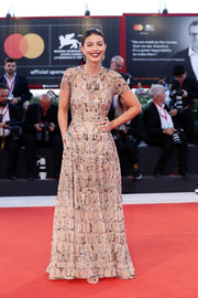 Alessandra Mastronardi sparkled in a sequin-embellished nude gown at the Venice Film Festival screening of 'About Endlessness.'