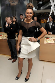 Jessica Ennis' white mini skirt added a futuristic touch to her look during the Omega store launch.