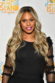 Laverne Cox got glam with this flowing wavy hairstyle for the Broadway opening of 'Once on This Island.'
