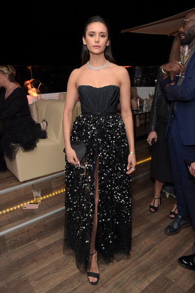 Nina Dobrev got glam in a strapless Dior gown with a sparkling skirt for the 'Once Upon a Time in Hollywood' after-party.
