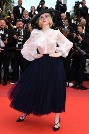 Elle Fanning kept it ladylike in a white pussybow blouse by Dior Couture at the 2019 Cannes Film Festival screening of 'Once Upon a Time in Hollywood.'