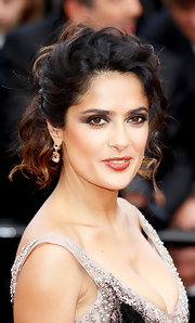 Salma Hayek attended the premiere of 'Once Upon a Time' wearing her ombre curls in a sexy variation of the ponytail.