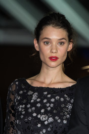 Astrid Berges Frisbey sealed off her look with a vibrant red lip.