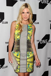 Tinsely stood out in a printed Lemon-Lime Spring 2010 sheath dress, featuring a metallic-detailed waistline.