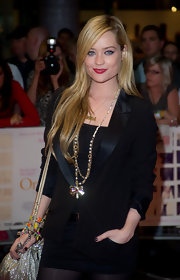 Laura Whitmore glammed up her black skirt suit with a gold chain necklace featuring pearl accents and a bow pendant.