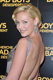 Katherine Heigl attended the 'One for the Money' premiere in Paris wearing her hair in a classic low bun with side-swept bangs.
