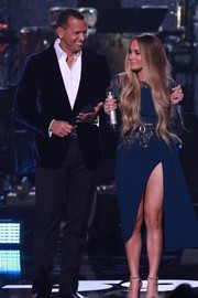 Jennifer Lopez flashed an eyeful of leg in a high-slit, embellished dress by Elie Saab Couture at the 'One Voice: Somos Live!' concert.