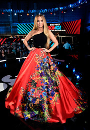 Jennifer Lopez wowed in a Romona Keveza one-shoulder gown with a voluminous floral skirt at the 'One Voice: Somos Live!' concert.
