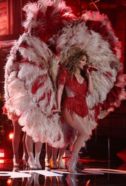 Jennifer Lopez performed at the 'One Voice: Somos Live!' concert wearing a fringed red bodysuit with waist cutouts.