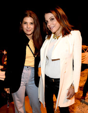 Bethenny Frankel looked polished in a white coat layered over a ribbed top and leather pants at the 'One Voice: Somos Live!' concert.