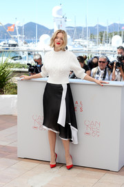 Lea Seydoux dolled up her casual top with a floaty black-and-white asymmetrical skirt, also by Louis Vuitton.