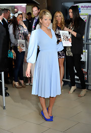 Lydia Rose Bright's ensemble, consisting of simple blue pumps and a wrap dress had a timeless appeal.