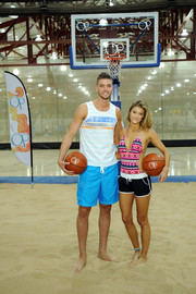 SI Swimsuit model Nina Agdal sported a colorful monokini for her promo basketball game with Chandler Parsons.