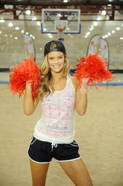 Nina Agdal layered a sheer white tank top over a colorful monokini for a spring kickoff event.