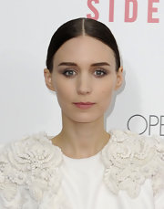 Rooney's sharp, slicked-back hairstyle put all the focus on her taupe shadow.