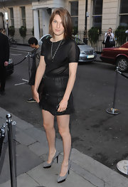Ben paired her black mini skirt with gray and black suede platform pumps.