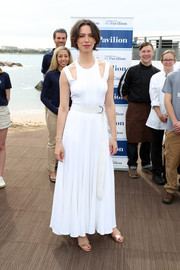 Rebecca Hall kept it breezy in a white maxi dress with shoulder cutouts when she attended the opening of the American Pavilion at Cannes.