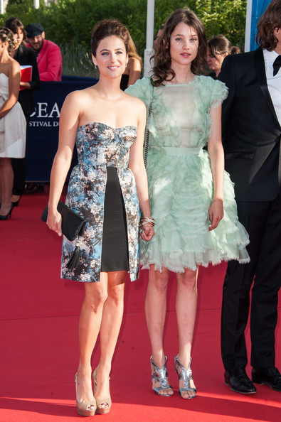 Astrid Berges Frisbey balanced out her girly dress with edgy Rupert Sanderson cutout heels, in silver.