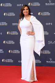 Mariska Hargitay attended the 2018 Monte Carlo TV Festival opening ceremony wearing an asymmetrical white column dress with cape detailing.