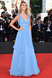 Sveva Alviti got all dolled up in a pastel-blue Alberta Ferretti empire gown, featuring a plunging neckline and a tiered skirt, for the Venice Film Festival opening ceremony.