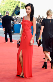 Ekaterina Mtsitouridze chose a sultry red one-shoulder gown for the Venice Film Festival opening ceremony.