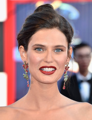 Bianca Balti complemented her updo with a dazzling pair of dangling gemstone earrings.